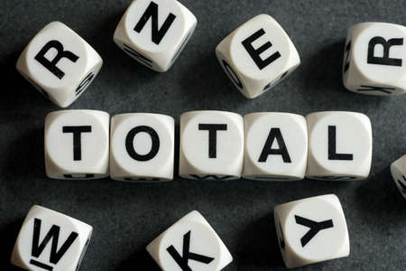 orthography: Word total on white toy cubes Stock Photo