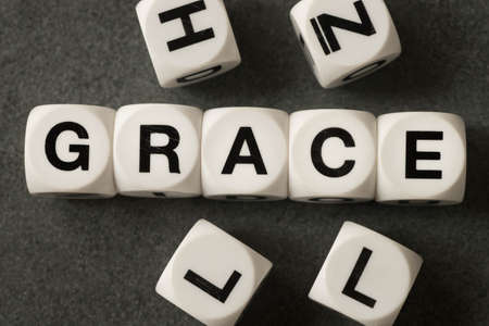 clemency: word grace on white toy cubes Stock Photo