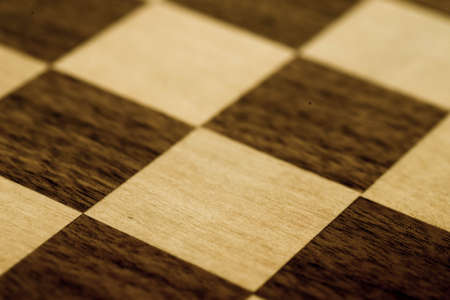 chess board: black and white wooden chessboard closeup