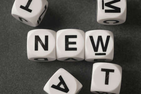orthography: word new on white toy cubes Stock Photo