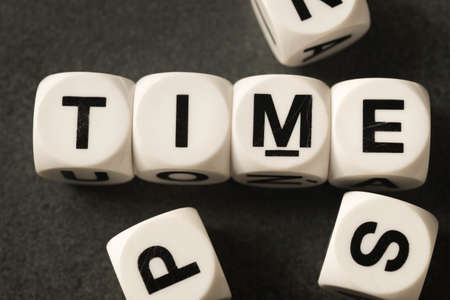 orthography: word time on white toy cubes