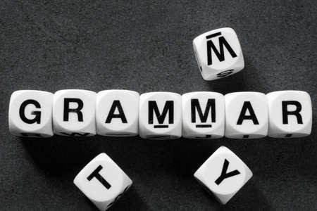 Gramática de la palabra en cubos de juguete blanco Foto de archivo - 78741825