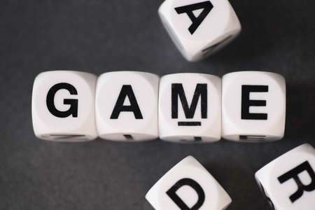 orthography: word game on white toy cubes