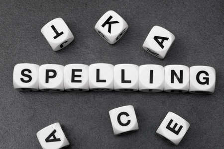 orthography: word spelling on white toy cubes Stock Photo