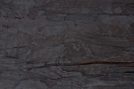 dark weathered rarred wooden backgroung texture