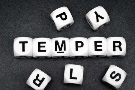 orthography: word temper on white toy cubes