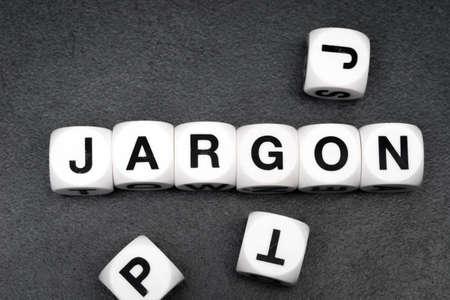 jargon: word jargon on white toy cubes