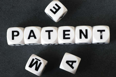 orthography: Word patent on white toy cubes