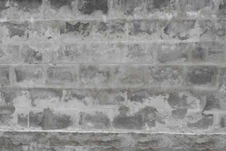 solid background: Old weathered grey brick wall texture background