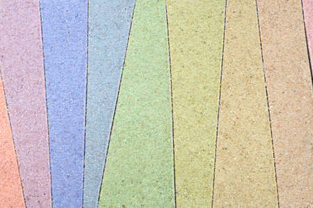 colorful stripped pattern drawing in sand background