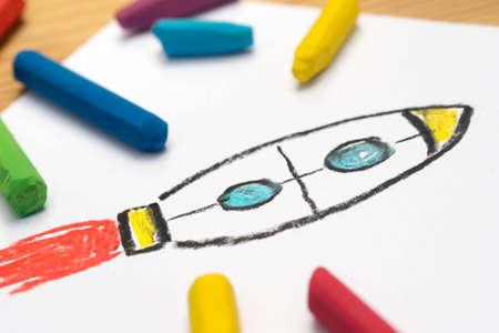 Child crayon drawing, rocket, selective focus