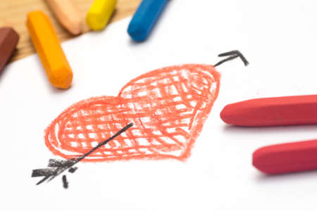 Child crayon drawing, heart and arrow, selective focus Stock Photo