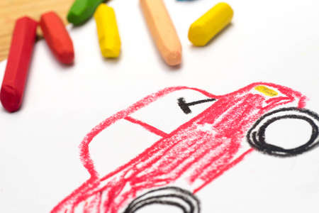 Child crayon drawing, red auto, selective focus Stock Photo