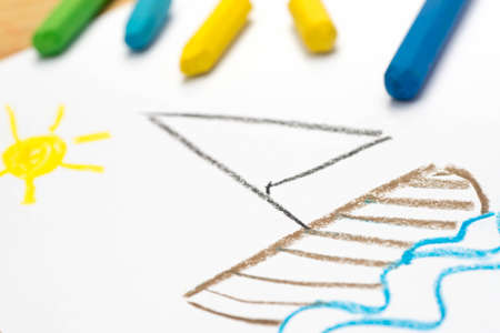 Child crayon drawing, sail boat, selective focus