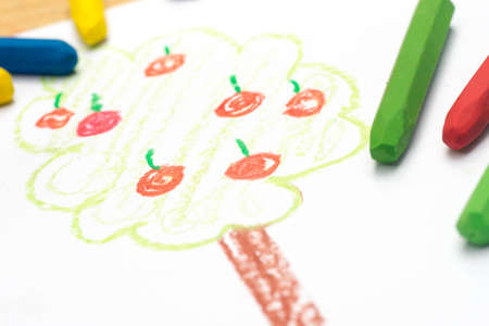 Child crayon drawing, apple tree, selective focus
