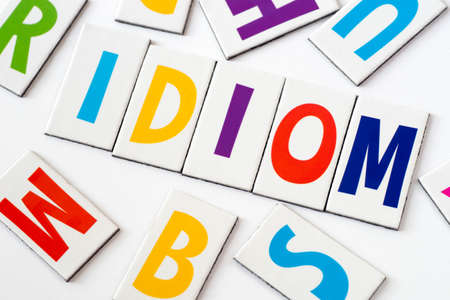 word idiom made of colorful letters on white background