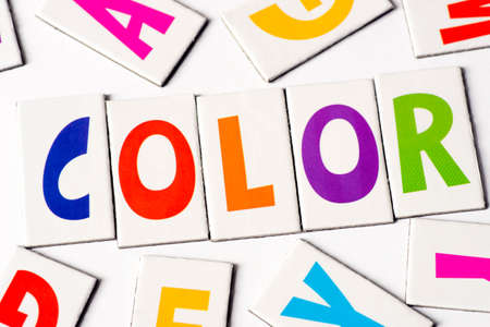 orthography: word color made of colorful letters on white background