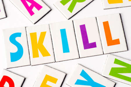 word skill made of colorful letters on white background