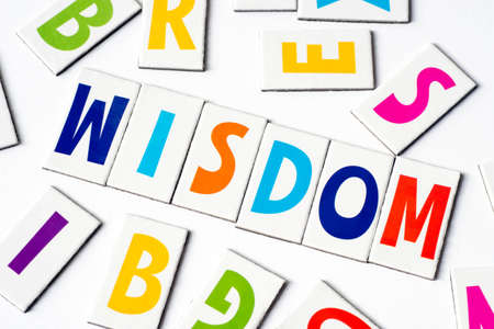 word wisdom made of colorful letters on white background