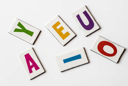 Colorful letters vowels on white background Фото со стока