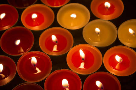 closeup to burning tealights in warm colors Stock Photo