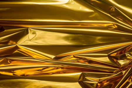 golden  color folded metallic foil abstract bacgkground