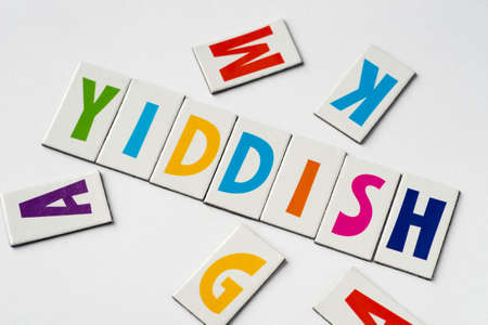 Word Yiddish made of colorful letters on white background