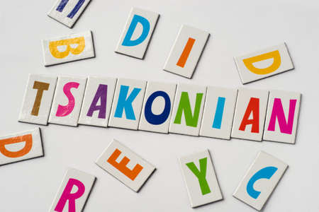 word Tsakonian made of colorful letters on white background