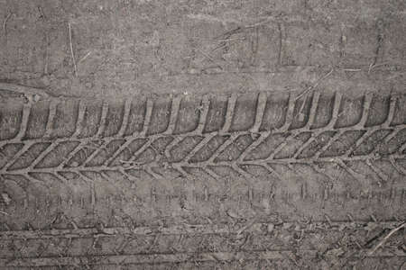 tyre track on  mud background texture