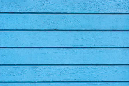 old weathered blue color painted wooden wall background texture
