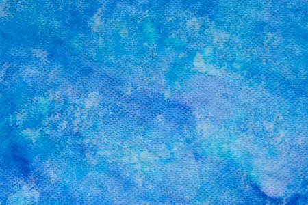 watercolor blue color painted on paper background texture Stock Photo