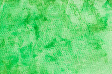 green watercolor color painted on paper background texture Stock Photo