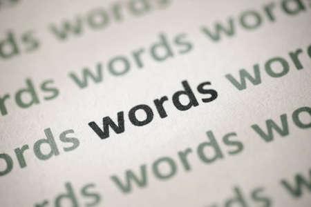 word language printed on white paper macro