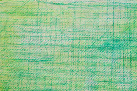 green color crayon doodles drawing on wtecolor painted background texture Stock Photo