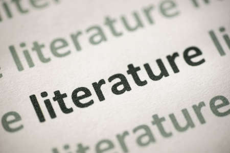 word literature printed on white paper macro