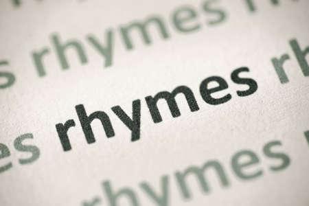 word rhymes printed on white paper macro Stok Fotoğraf