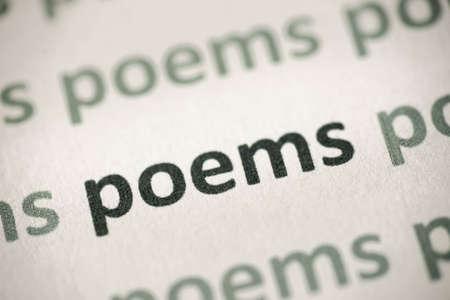 word poems printed on white paper macro Banco de Imagens