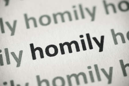 word homily printed on white paper macro