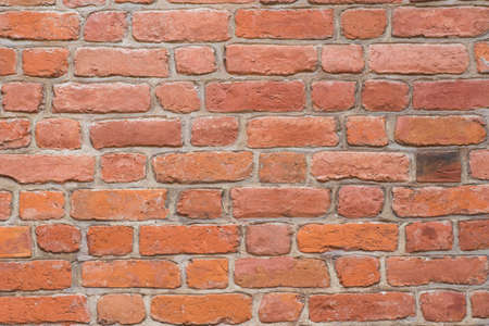 closeup to red brick wall background texture