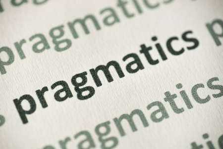 word pragmatics printed on white paper macro