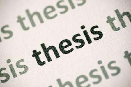word thesis  printed on white paper macro