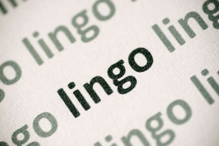word lingo printed on white paper macro Stock Photo