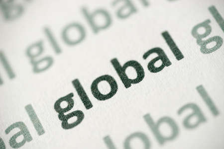 word global printed on white paper macro