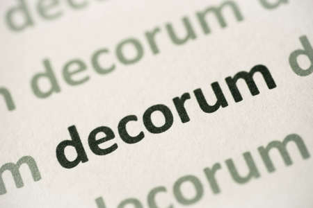 word decorum printed on white paper macro