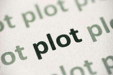 word plot printed on white paper macro Stock Photo