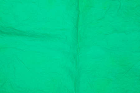 green color creased tissue paper background texture Stock Photo