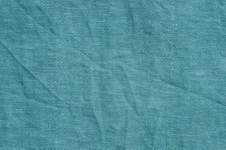turquoise color  creased fabric background texture Stock Photo
