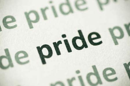 word pride  printed on white paper macro