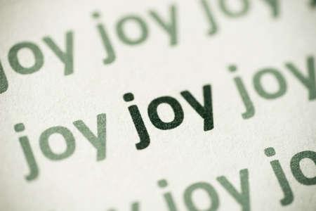 word joy printed on white paper macro Archivio Fotografico