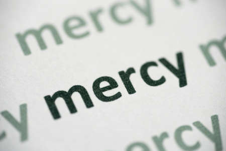 Word mercy printed on white paper macro